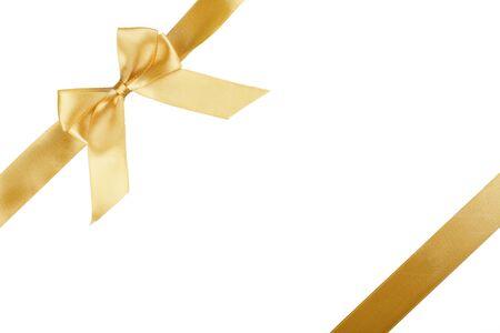 Złota satynowa wstążka z kokardką na białym tle Zdjęcie Seryjne
