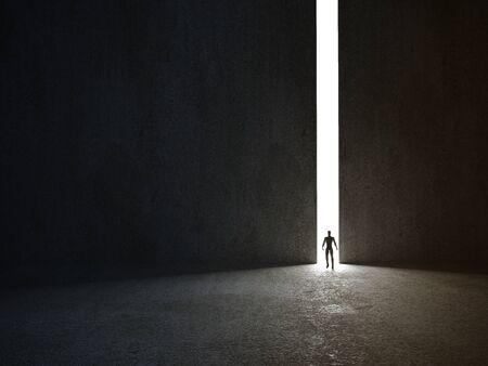Abstract man in dark concrete interior with glowing doorway and light rays coming in. 3d rendering