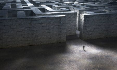 Man standing at the entrance of a huge stone maze. 3D Rendering 免版税图像