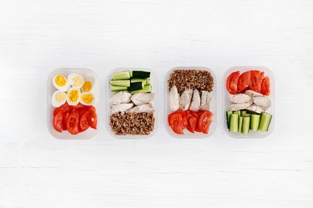 Chicken breast and vegetables in containers. Flat lay