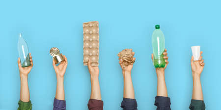Concept of garbage sorting and ecology. Photo for website banner. Hands holding different trash