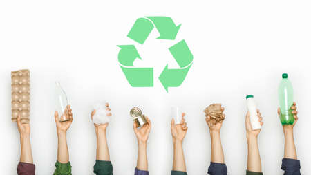 Ecology human hand holding stuff for recycle 免版税图像