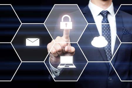 Businessman hand locks in screen on dark background. 免版税图像