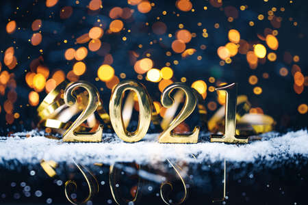 Christmas year from golden numbers with gold sparkle bokeh abstract background