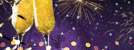 Tow champagne glasses with fireworks on purple background, copy space