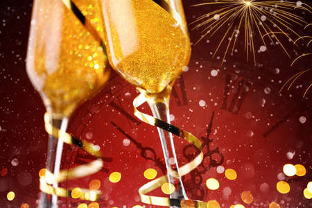 Two champagne glasses with fireworks on red background, copy space 版權商用圖片