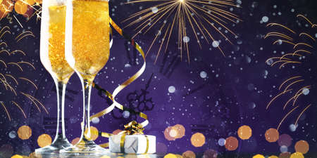 Two glasses of champagne with golden lights and fireworks, copy space