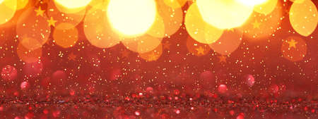Christmas background - red glitter with golden lights, copy space