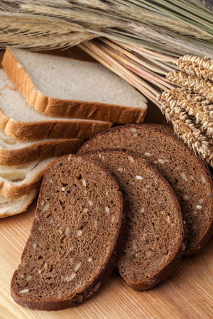 wariety: Wariety of bread on wooden table Stock Photo