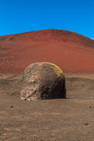 volcanism: Volcanic bomb near Montana Colorada in Lanzarote, Canary Islands, Spain. Stock Photo