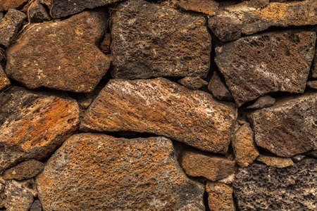 Background image of volcanic lava stones wall.