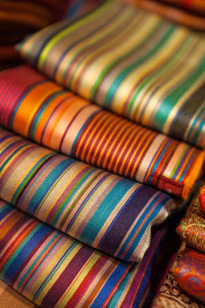 Colorful silk scarfs in a market. Imagens