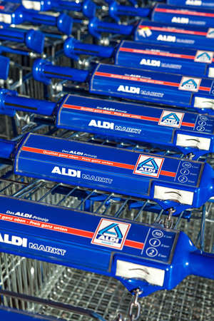 BERLIN, GERMANY - NOVEMBER 16 , 2014: Shopping trolleys near Aldi supermarket in Berlin. Aldi is a global discount supermarket chain based in Germany.