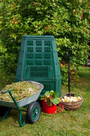 Compost bin and mulch in a garden.