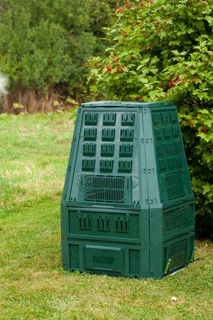waste: Compost bin in a garden.