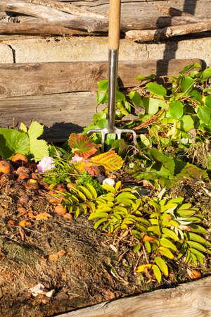 Garden fork in a compost bin