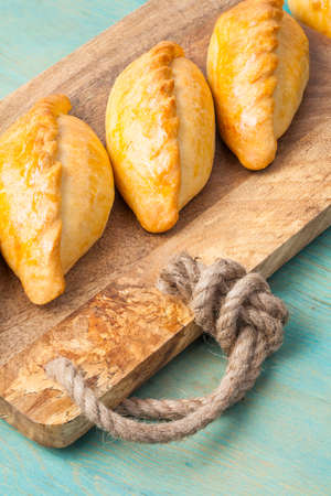 Kibinai kybyn,kybynlar,chiburekki,shishlik are traditional pastries filled with mutton and onion, popular with Karaite ethnic minority in Lithuania. Kibinai usually served with chicken broth.