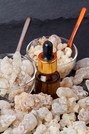 Bottle with organic essential aroma oil from Frankincense tree (Boswellia sacra) tree resin and Frankincense insence.