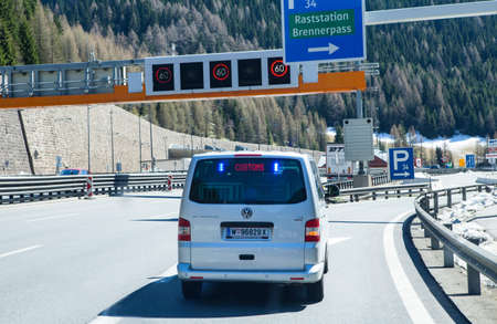 BRENNER PASS, AUSTRIA - APRIL 20, 2016: A hidden customs car on the Brennero border pass. A car must follow the customs car to a parking place for a customs control. Editorial