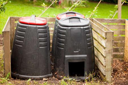 kitchen scraps: Compost bin in a summer garden