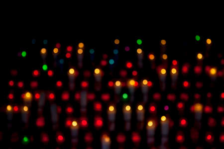 montserrat: Blurred abstract background with candle lights bokeh in a Montserrat monastery, Catalonia, Spain