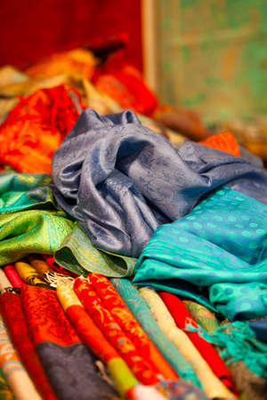 Colorful silk and wool scarfs in a market Stock Photo