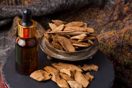 Agarwood, also called aloeswood, oil and incense chips Imagens