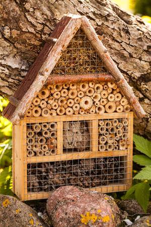 Insect hotel in a summer garden 版權商用圖片