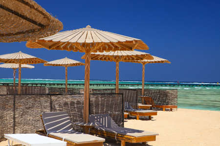 Egyptian parasol on the beach of Red Sea. Marsa Alam, Egypt.
