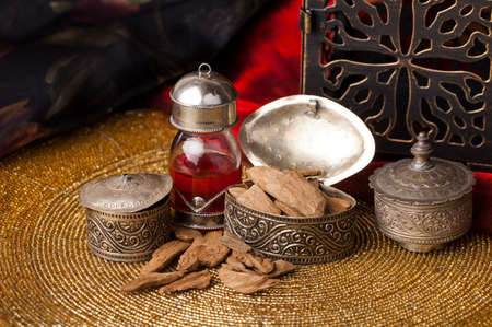 Agarwood, also called aloeswood, essential oil and incense chips Zdjęcie Seryjne