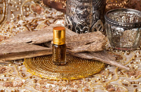 Agarwood, also called aloeswood, essential oil and incense chips Stok Fotoğraf