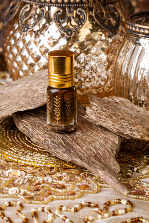 Agarwood, also called aloeswood, essential oil and incense chips Stockfoto