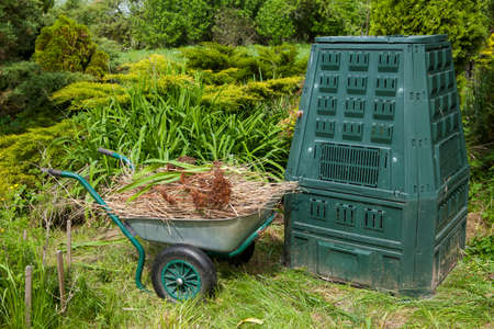 Image of mulch and compost bin in a garden.