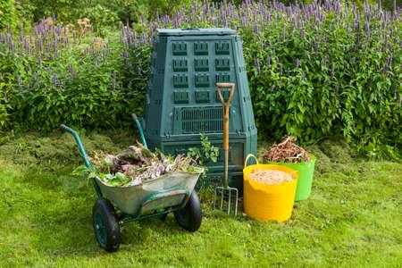 Compost bin and mulch in a summer garden