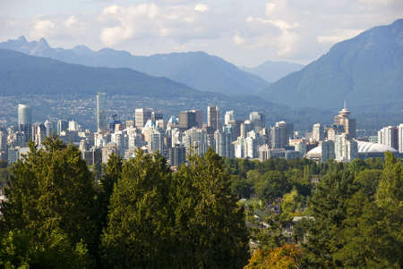 Downtown Vancouver with north shore mountains. Stock Photo