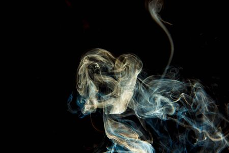 Smoke from an extinct candle on a black background