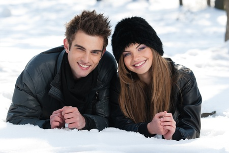 young couple having fun in the park, in winter holidays Reklamní fotografie