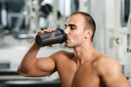bodybuilder in the gym, drinking a protein shake photo
