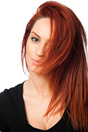 portrait of a beautiful young red head woman, on white background