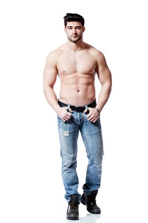 full body shot of a handsome young man, wearing blue jeans Stock Photo