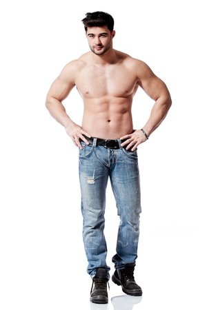 full body shot of a handsome young man, wearing blue jeans Reklamní fotografie - 12859881