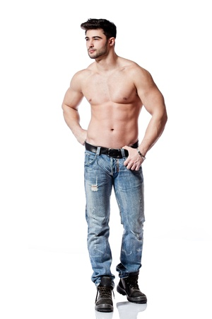 full body shot of a handsome young man, wearing blue jeans photo