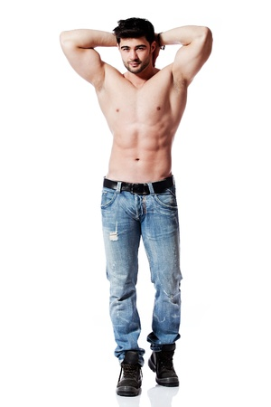 male chest: full body shot of a handsome young man, wearing blue jeans Stock Photo