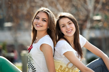 two friends, happy, young women in the park