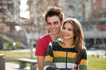young couple having fun in the park Stock Photo