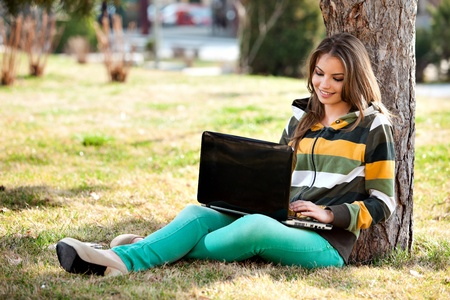young woman with laptop, relaxing in the park Reklamní fotografie - 13225323