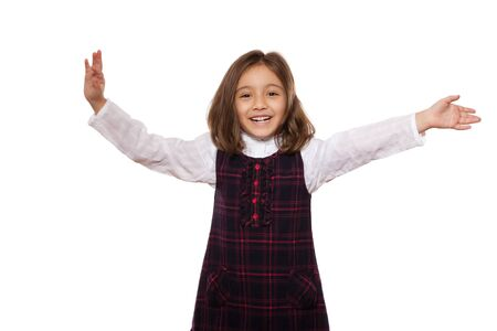 portrait of a lovely little girl, smiling, dressed in school uniform, isolated on white background Stock Photo - 13256272
