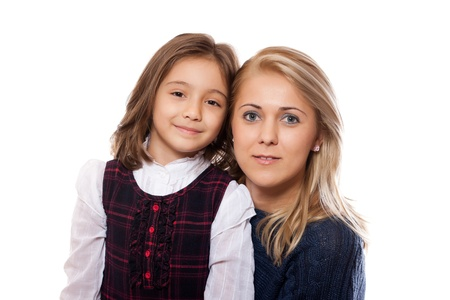 portrait of a lovely little girl and her mother, isolated on white background photo