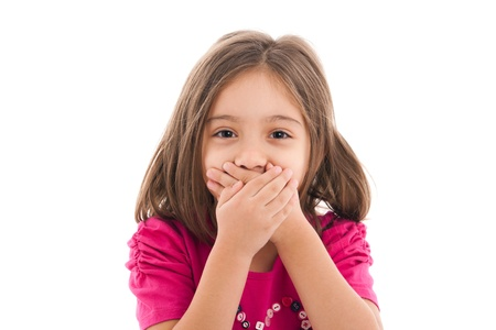 mistake: portrait of a lovely little girl, covering her mouth with both hands, isolated on white background