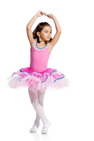 ballet ni�as: hermosa ni�a peque�a, vestida como una bailarina, aisladas sobre fondo blanco Foto de archivo